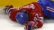 John Allemang says the carnage on the hockey rink has become too much to bear. In the latest incident, Max Pacioretty of the Montreal Canadiens suffered a broken vertebra and severe concussion. (Shaun Best/Reuters/Shaun Best/Reuters)