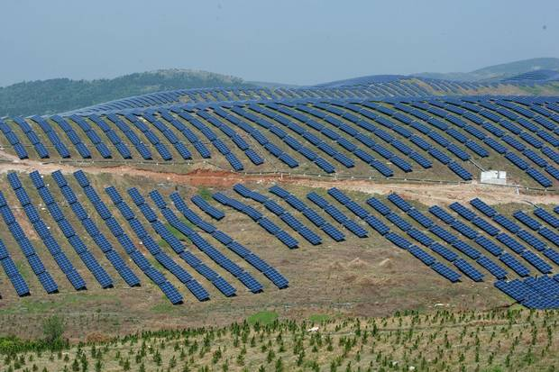 Solar panels on hills in Chaohu, in China's Anhui Province. The cost of solar cells has now come very close to a threshold where it is cheaper to generate solar electricity than coal, even without government subsidies.