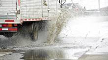 Truckers would never splash anyone intentionally, would they? (Ola Dusegard.se/iStockphoto)
