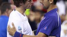 Britain's Andy Murray, left, embraces Serbia's Novak Djokovic after defeating him in the men's singles final match at the U.S. Open tennis tournament in New York on Sept. 10, 2012. (Kevin Lamarque/Reuters)