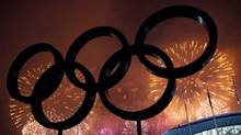 The Olympic Rings are silhouetted as fireworks light up the sky during the closing ceremonies at the 2014 Sochi Winter Olympics on Feb. 23, 2014. (NATHAN DENETTE/THE CANADIAN PRESS)