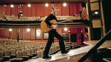 Gordon Lightfoot strides onto the stage during a visit to Massey Hall in Toronto on April 10, 2012. (Moe Doiron/Moe Doiron/The Globe and Mail)