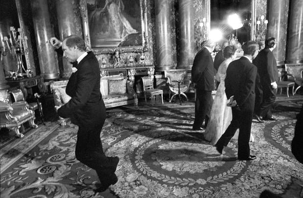 Pierre Trudeau pirouettes behind the Queen during a May 7, 1977, photo session at Buckingham Palace in London.