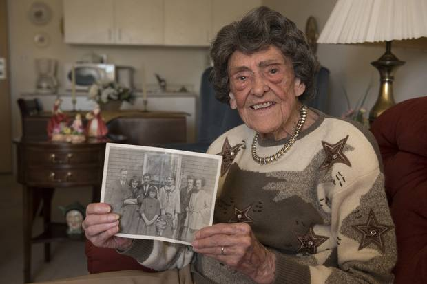 Kaye Chapman, 104, holds a photo of her parents and siblings taken a few years after the Halifax explosion of 1917. She now lives in Saint John.