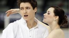 Tessa Virtue and Scott Moir of Canada perform the ice dance program, at the World Figure Skating Championships in Turin, Italy, Friday, March 26, 2010. (Antonio Calanni)