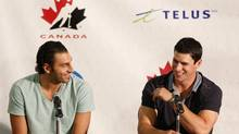 Players Roberto Luongo (L) and Sidney Crosby share a laugh during a Hockey Canada news conference in Calgary, Alberta, August 25, 2013. Luongo and Crosby will be taking part in the Hockey Canada's National Men's Team orientation camp from August 25-28 in Calgary. The selected team will then compete in the Sochi winter Olympics next year in Russia. (TODD KOROL/REUTERS)