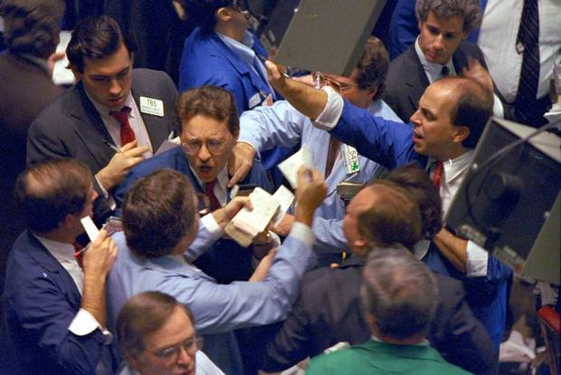 **FILE** Traders on the floor of the New York Stock Exchange work frantically as panic selling swept Wall Street in this Oct. 19, 1987 file photo. In the 20 years since one of Wall Street's worst crashes, the markets have grown bigger, more complex and faster. Investors have become increasingly aggressive, whether buying or selling. So while Wall Street was devastated by a 508-point plunge in the Dow Jones industrials on Oct. 19, 1987, a drop of that size today, while much smaller on a percentage basis, remains frightening. (AP Photo/Peter Morgan, File)