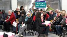 People sit in a waiting area for turn to be injected with the H1N1 flu vaccine at a clinic in Ottawa. (FRED CHARTRAND/Fred Chartrand/The Canadian Press)