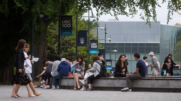 People walk on the Main Mall at the University of British Columbia campus in Vancouver, B.C., on Thursday August 20, 2015.