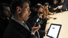 In this Jan. 27, 2010 file photo, the Apple iPad is examined after its unveiling at the Moscone Center in San Francisco. (Marcio Jose Sanchez/AP)