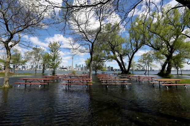Flooded picnic area and grass fields on Olympic Island.