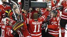 Canada's Jonathan Huberdeau (C) lifts the Canada-Russia Challenge Trophy after winning in sudden death overtime against against Russia at the Metro Centre in Halifax, Nova Scotia, August 14, 2012. (PAUL DARROW/REUTERS)