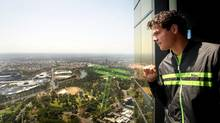 Canada's Milos Raonic poses for a photo at the at Eureka sky deck in Melbourne, Australia, Sunday. (Fiona Hamilton/AP)