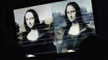 "Horizontal comparison lines between a painting attributed to Leonardo da Vinci and representing Mona Lisa (L) and the ""Joconde"" painting are pictured on a TV screen during a presentation in Geneva September 27, 2012. The Mona Lisa Foundation, a non-profit organisation, presented today historical, comparative and scientific evidence, which demonstrate that there have always been two portraits of the Mona Lisa by Leonardo da Vinci, the ""Earlier Version"", made 10 years earlier than the ""Joconde"" that is displayed in Le Louvre in Paris. (Reuters)"