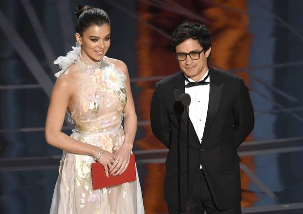 Hailee Steinfeld, left, and Gael Garcia Bernal present the award for best animated feature film at the Oscars on Sunday, Feb. 26, 2017, at the Dolby Theatre in Los Angeles.