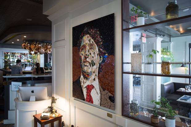 Glass artwork of Prime Minister Justin Trudeau at La Pentola.
