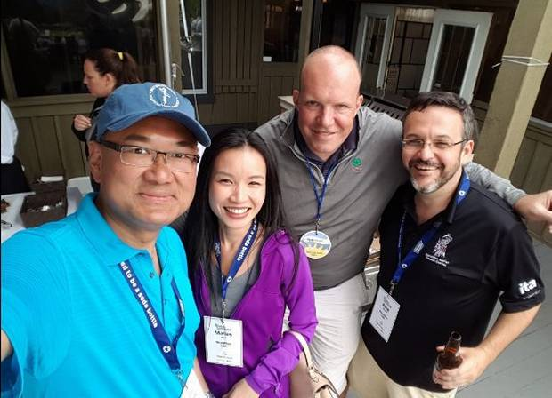 Marian Ngo (second from left) and Byng Giraud (far right) at a 2016 golf tournament and fundraiser with B.C. Liberal MLA John Yap (far left).