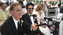 Eddie Pebenito, right, uses a GoPro camera to video record his marriage to partner Don Wiggins. More than 100 couples took part in a mass LGBT wedding in Toronto on June 26, 2014. (Fred Lum/The Globe and Mail)