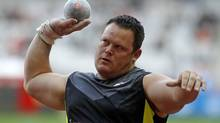 Dylan Armstrong of Canada competes in the shot put event during the IAAF Diamond League athletics meeting at the Stade de France Stadium in Saint-Denis, near Paris, July 6, 2012. (BENOIT TESSIER/REUTERS)
