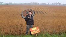 Protester Pierre Batellier stands in front of the field a company has selected to search for natural gas deposits, in St-Marc sur Richelieu, Que., in Sept. 30, 2010. (Christinne Muschi For The Globe and Mail)