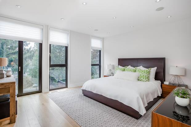 The master suite has floor-to-ceiling windows and a French balcony.