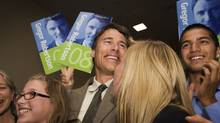 Gregor Robertson celebrates with his family, wife Amy Robertson, daughters Terra and Hanna Robertson and his son Jinagh Navas Rivas, after being elected the Vision Vancouver Mayoral candidate on June 15, 2008. (JENNIFER ROBERTS/THE GLOBE AND MAIL/JENNIFER ROBERTS/THE GLOBE AND MAIL)