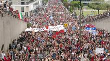Thousands of protesters march through the streets of Montreal in a massive protest against tuition fee hikes on Tuesday, May 22, 2012. (Ryan Remiorz/THE CANADIAN PRESS)