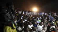 "Residents watch the premiere of ""Kony 2012"", a 30-minute YouTube film created by the nonprofit group Invisible Children, in Lira district located 376 km (234 miles) north of Uganda's capital Kampala March 13, 2012. Lira was one of the areas that was ravaged by 20 years of the Lords Resistance Army (LRA) rebellion. Picture taken March 13, 2012. (JAMES AKENA/REUTERS/JAMES AKENA/REUTERS)"