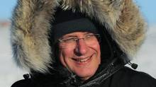 Prime Minister Stephen Harper bundles up in a parka as he tours Frobisher Bay in Iqaluit on Feb. 23, 2012. (SEAN KILPATRICK/THE CANADIAN PRESS)