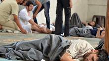 A survivor from what activists say is a gas attack rests inside a mosque in the Duma neighbourhood of Damascus August 21, 2013. (© Stringer . / Reuters)