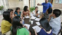 Undocumented students at UCLA in Los Angeles prepare paperwork for the Deferred Action for Childhood Arrivals program on Aug. 15, 2012. President Barack Obama's administration announced on June 15 it would relax deportation rules so that many young illegal immigrants who came to the U.S. as children can stay in the country and work. The changes went into effect on Wednesday. (JONATHAN ALCORN/REUTERS)