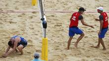 Norway's Martin Spinnangr and Tarjei Viken Skarlund celebrate at the end of their men's preliminary round beach volleyball match against Canada at the London 2012 Olympic Games at Horse Guards Parade July 30, 2012.  (Reuters)