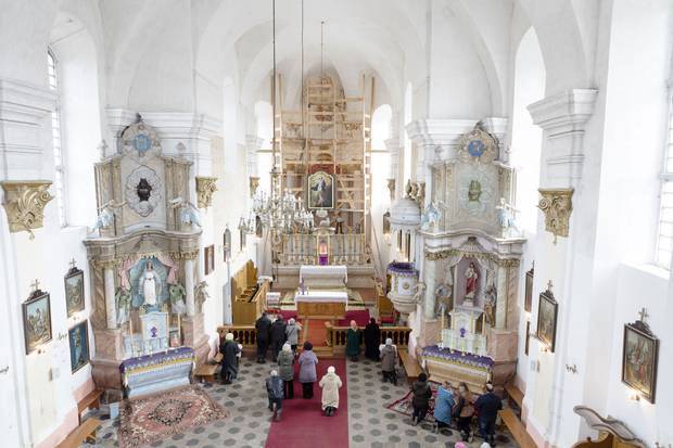 A ceremony in the Roman Catholic Church of the Assumption of Virgin Mary in Piedruja, a town in which some residents wish the country had not joined the European Union or NATO, and had instead remained closer to Russia.