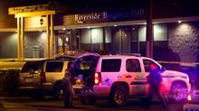 RCMP officers work outside a banquet hall in Richmond, B.C., where four men were shot late on Jan. 16, 2013. (Darryl Dyck/The Canadian Press)