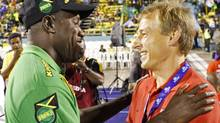 Jamaica's coach Theodore Whitmore (L) greets coach Juergen Klinsmann of the U.S. before their 2014 World Cup qualifying soccer match in Kingston September 7, 2012. REUTERS/Gilbert Bellamy (GILBERT BELLAMY/REUTERS)