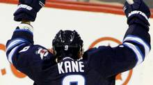 Winnipeg Jets forward Evander Kane (9) scores on New Jersey Devils goalie Johan Hedberg (1) during the first period at the MTS Centre. Bruce Fedyck-US PRESSWIRE (Bruce Fedyck/US PRESSWIRE)