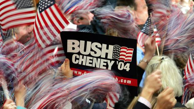 Bush supporters wave American flags at the Ronald Reagan Building in Washington, D.C., on Nov. 3, 2004, as Democrat John Kerry concedes the election in a speech from Boston.