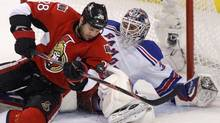 Ottawa Senators' Zenon Konopka (L) drives to the net on New York Rangers goalie Henrik Lundqvist during the first period in Game 3 of the NHL Eastern Conference quarter-final hockey playoff in Ottawa (BLAIR GABLE/Reuters)