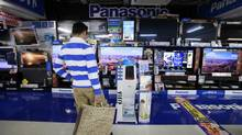 A man looks at Panasonic Corp's Viera TVs displayed at an electronics store in Tokyo October 28, 2012. (YURIKO NAKAO/REUTERS)
