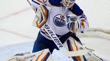 Edmonton Oilers' goalie Devan Dubnyk makes a blocker save against the Vancouver Canucks during the second period of an NHL hockey game in Vancouver, B.C., on Sunday January 20, 2013. (DARRYL DYCK/THE CANADIAN PRESS)