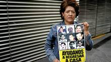 Marina Armenta, whose husband Eduardo Toyota Espinoza disappeared in Jun 2009 in the town of Nuevo Laredo in the north of Mexico, photographed while holding a picture of her him in Mexico City, May 13, 2012. (Fernando Morales/Fernando Morales/The Globe and M)