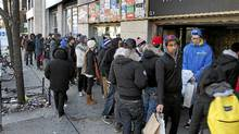 In the search of good deals shoppers line up outside of Livestock, a shoe store on Spadina Ave, during Boxing Day in Toronto on Dec. 26 2011. (Fernando Morales/Fernando Morales/The Globe and Mail)
