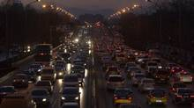 In this Tuesday, Dec. 14, 2010, file photo, vehicles pack a main road during rush hour in Beijing. (Alexander F. Yuan/AP)