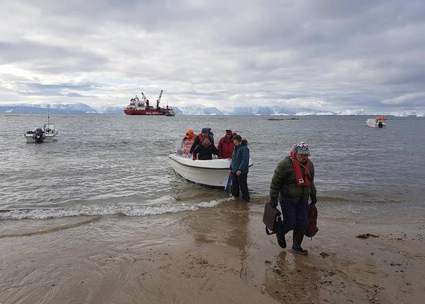 Commissioners coming ashore in Siorapaluk, Greenland.