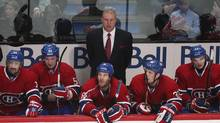 Montreal Canadiens head coach Michel Therrien watches from behind the bench during third period NHL hockey action against the Toronto Maple Leafs in Montreal, January 19, 2013. (CHRISTINNE MUSCHI/R