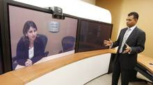Nitin Kawale, president of Cisco Systems Canada in Toronto, uses video conferencing to speak with his mentor, Ioana Birleanu, a Cisco business manager based in the Netherlands. (Peter Power/The Globe and Mail/Peter Power/The Globe and Mail)
