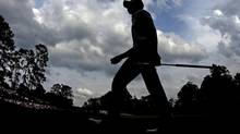 Silhouette of golfer Guan Tianlang (Charlie Riedel/The Associated Press)