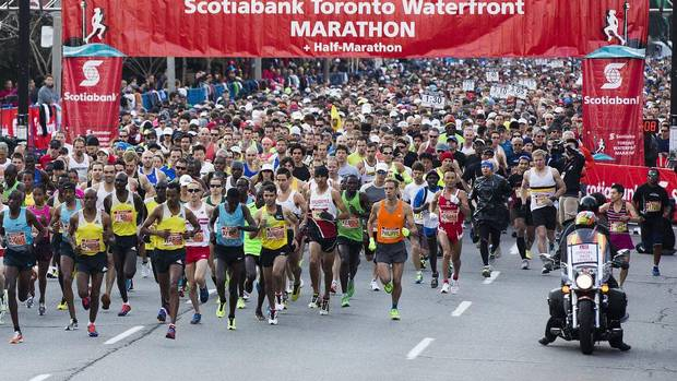 People take off at the start line during the Scotiabank Toronto Waterfront Marathon in Toronto on Oct. 20, 2013. (Michelle Siu For The Globe and Mail)