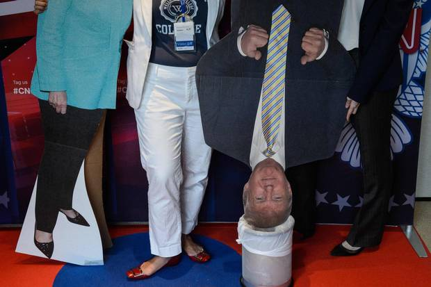 A cardboard cutout of Donald Trump is placed in a bin as people attend a live coverage of the U.S. elections event organised by the American Chamber of Commerce in Hong Kong on Nov. 9, 2016.