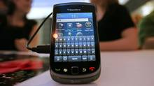 The Blackberry Torch 9800 smartphone is seen after being unveiled at a news conference August 3, 2010 in New York City. (Mario Tama/Getty Images)